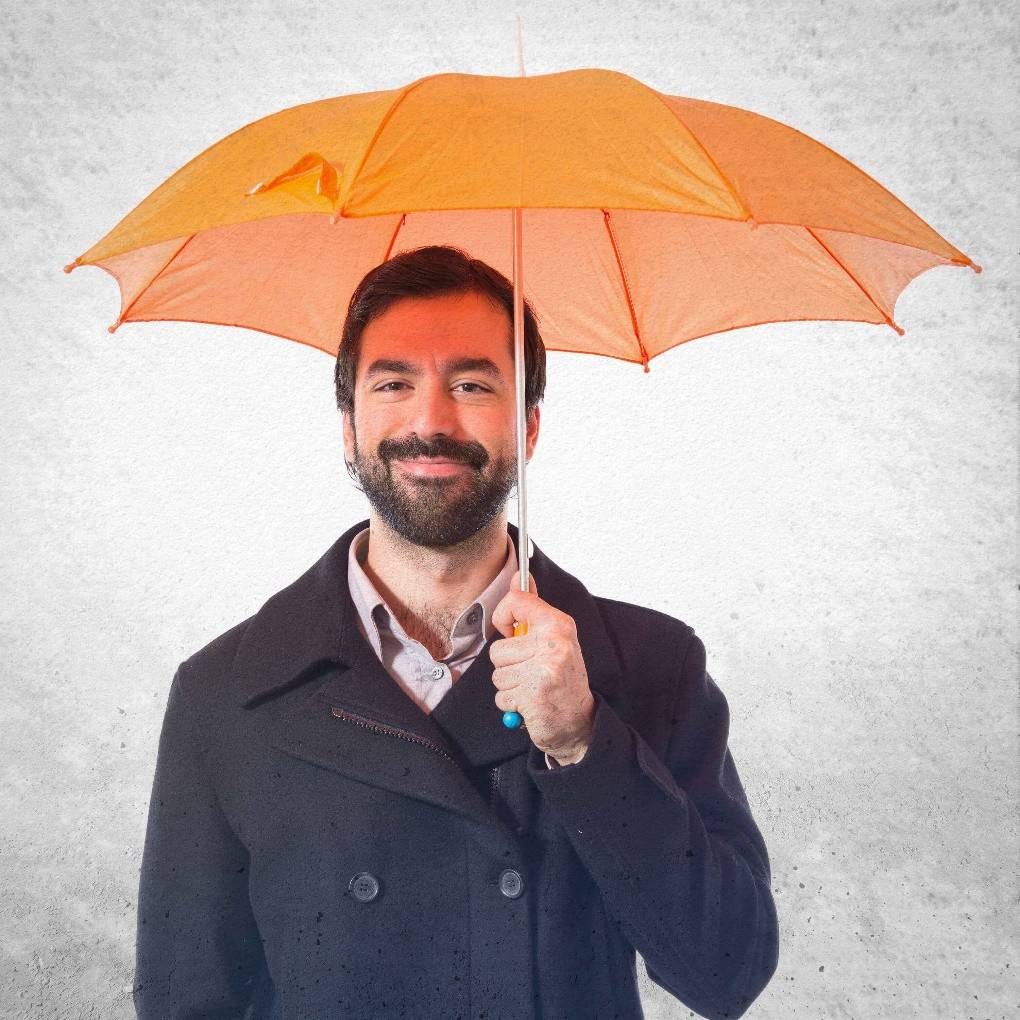 Man holding an orange umbrella