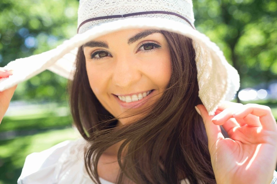 Young woman in white brim hat
