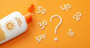 Different sunscreen SPF ratings written with sunscreen lotion